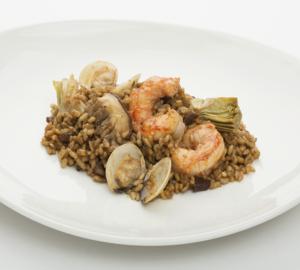Arròs de cloïsses i carxofes gourmet Paella amb cloïsses, gamba pelada, carxofes i ceps.